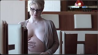 pregnant, big tits female in a frivolous outfit public space exposed