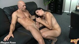 Busty brown-haired Megan Foxx blowing a immense man meat