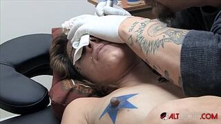 Amina Sky gets a face tattoo while completely stripped
