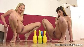 Lesbians knock down bowling pins with their piss