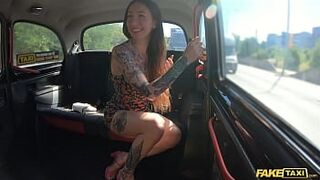 Fake Taxi Tattooed amazing seduces the taxi driver by showing off her tattooed body