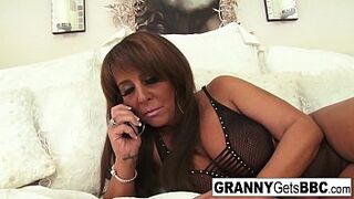 Chesty darkis mature mom takes the inky penis in her bed
