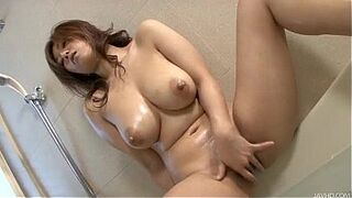Gorgeous Japanese bitch Naho oils up her amazing body and then fingers her hairy m