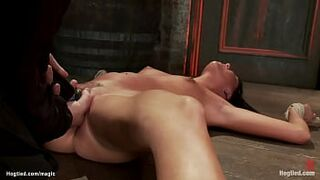 Bound beauty in spread eagle on the floor