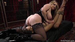 Tied up lesbo asshole humped by chesty dom