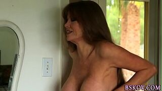 Chesty mom gets cum on face