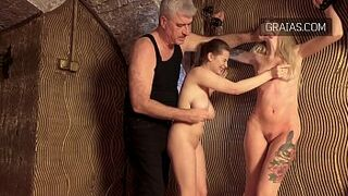 Stripped ladies being whipped