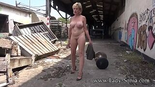 Mommy Woman Sonia strips completely without clothes open space