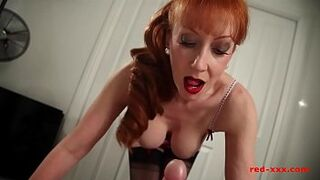 Sexy giant tit red-haired adult gives her guy a wank